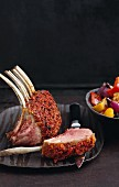 A rack of lamb with a tomato & sage crust