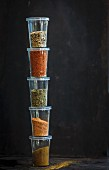 Barbecue spices in stacked plastic containers