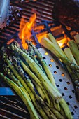 Grilled green asparagus on the barbecue
