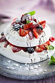 Pavlova with berries and mint