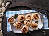 Turkey roulade kebabs with sage and dried tomatoes