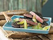 Tuna with a nigella crust and lime wedges
