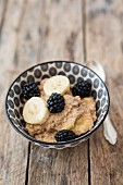 Tiger nut porridge with grain milk, banana and blackberries