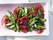 Pan-fried green asparagus with Italian beef ham