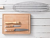 Assorted utensils for grilling fish