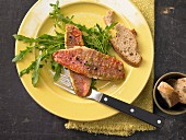 Fried rose fish with rocket