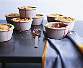 Rhubarb & apple crumble in small ramekins