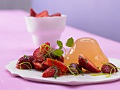 Apple & rhubarb jelly tipped onto a plate and served with marinated strawberries