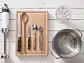 Assorted kitchen utensils for preparing creamy soups