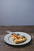 A slice of tomato quiche on a plate