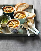 Minestrone with pasta and pesto in soup bowls