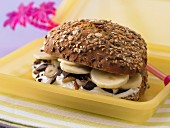 A banana roll with quark, chocolate and nuts