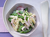 Pasta and asparagus salad with radish and turkey breast