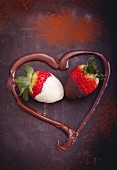 Strawberries dipped in chocolate framed by a melted chocolate heart