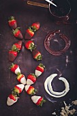 An XOXO greeting made of strawberries dipped in chocolate and melted chocolate