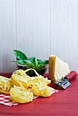 An arrangement of tagliatelle, basil and Parmesan