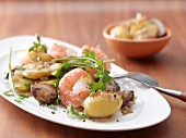 Fried potatoes with mushrooms and prawns