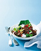 Short ribs with lemongrass, tamarind pasta and chilli on a bed of rice (Asia)