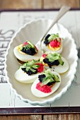 Eggs with a duo of caviar and cucumber