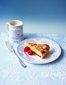 A slice of Bakewell tart with raspberries