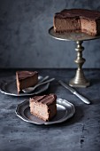 Sliced chocolate cheesecake with chocolate ganache