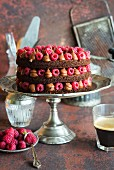 Rich moist chocolate cake with whipped chocolate ganache and raspberries, open layers