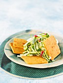 Spicy macadamia cheese crackers with courgette salad