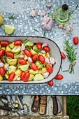 Oven-roasted potatoes with tomatoes, garlic and rosemary