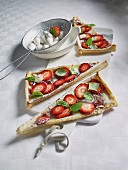 Puff pastry triangles with strawberries and mini mozzerella
