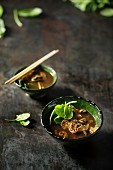 Miso soup with mushrooms and baby spinach