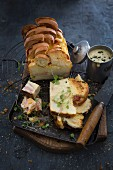 Savoury croque-monsieur bread-and-butter pudding with a Cheddar sauce