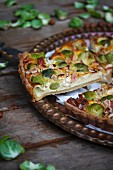 An apple and Brussels sprout quiche, sliced