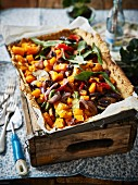 A vegan walnut and vegetable tart for a winter picnic