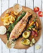 Grilled rainbow trout with avocado, tomato salad and potato crisps