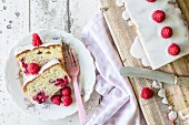 Cream cake with raspberries and fruit juice, sliced