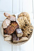 Various homemade breads in a bread basket (top view)