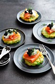 Avocado and sweetcorn blinis with lime crème-fraiche, smoked salmon and caviar