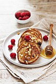 Quark and buckwheat pancakes with blueberries, raspberries and a honey nut topping