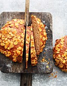 A loaf of wheat bread with dried apples and cornflakes