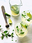Mojitos with lime, mint and ice cubes