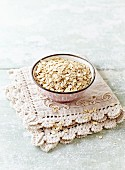 Organic barley flakes in a ceramic bowl