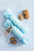 Two rolls of gift-wrapped biscuits