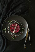 Beetroot tartlet with sesame seeds and cress