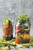 Layered salad in two glass jars