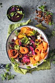 Salad with vegetable strips and a beetroot and pomegranate dressing