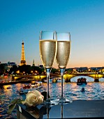 Two glasses of Champagne infront of a view of the Seine in Paris