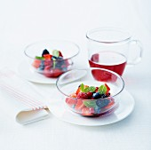Summer fruit salad with pomegranate juice and fresh mint