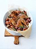 Roasted chicken in Crapaudine,with thyme,rosemary,Grenailles potatoes and shallots