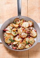 Fried potatoes with diced bacon