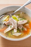 Clear soup with chicken and vegetables